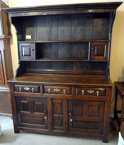 Click here to see more detail of an 18th century oak dresser