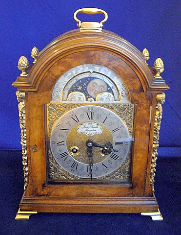 Click here to see more detail of an 18th-century-style walnut-cased bracket clock