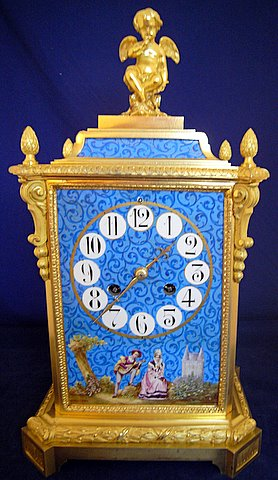 Click here to see more detail of a 19th century French gilt ormolu mantel clock with painted porcelain panels