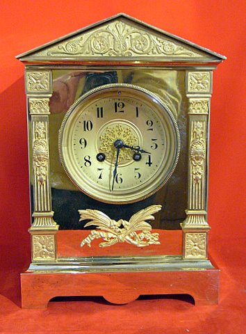 Click here to see more detail of a 19th century French mantel clock in a brass and gilt case