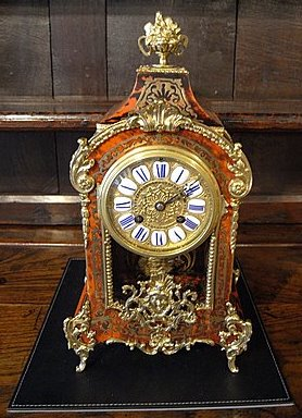 Click here to see more detail of a 19th century boulle mantel clock