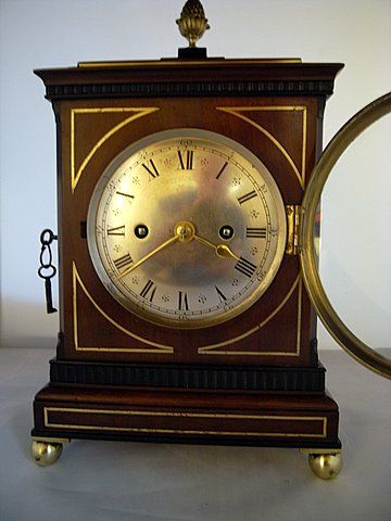 Click here to see more detail of a 19th century bracket clock by Arthur and Henry Rowley of London