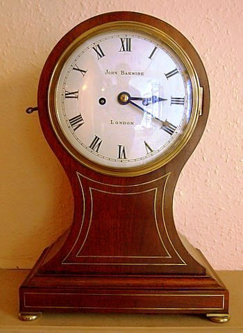 Click here to see some more detail of an early 19th century mahogany balloon mantel clock by John Barwise of London