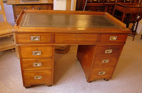 Click here to see more detail of a 19th century mahogany campaign desk