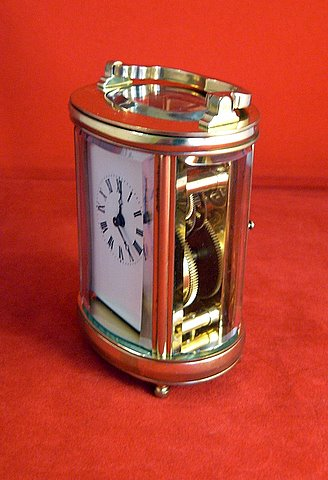 20th century miniature oval French carriage clock - angle