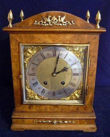Click here to see more detail of a burr walnut mantel clock