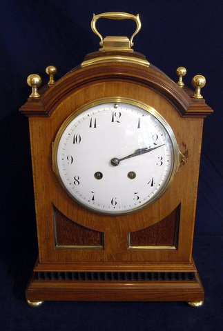 Click here to see more details of an Edwardian bracket clock in mahogany case with inlaid brass