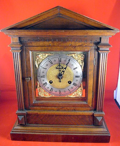 Click here to see more detail of an Edwardian mahogany mantel clock in an architectural case