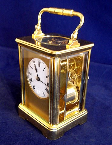 French brass carriage clock porcelain dial Roman numerals - angle