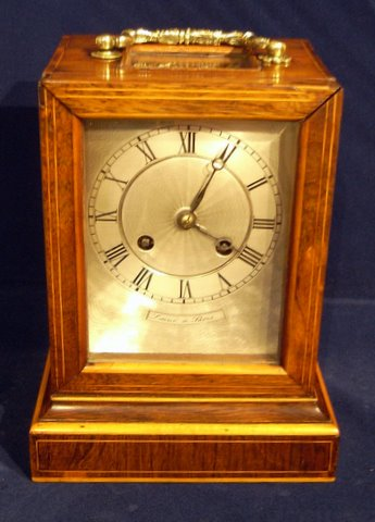 Click here to see more detail of a French rosewood mantel clock by Laine a Paris