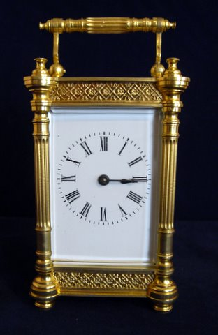 Click here to see more detail of a gilt brass cased carriage clock