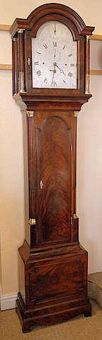 Click here to see more detail of a late 18th century London flame mahogany musical longcase
