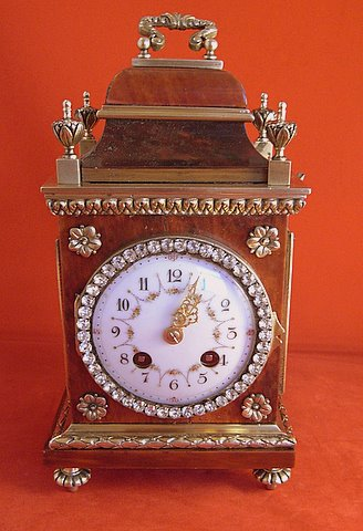 Click here to see more detail of a Louis XVI-style tortoiseshell and gilt mantel clock