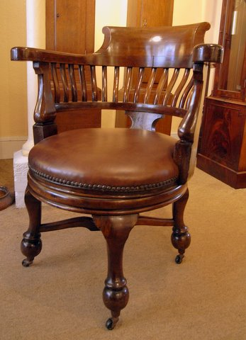 Click here to see more detail of a mahogany Edwardian captain's swivel chair