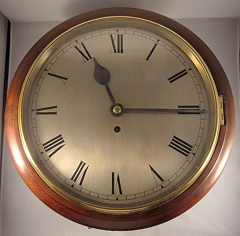 Click here to see more detail of a mahogany-cased silvered dial clock