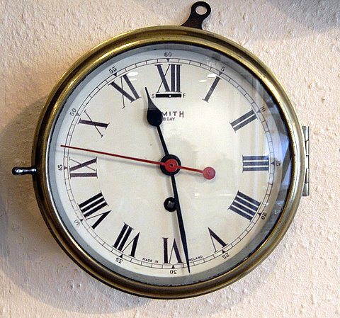 Click here to see more detail of a marine bulkhead clock by Smiths circa 1930