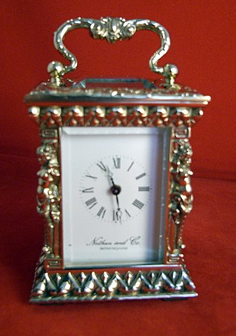 Click here to see more detail of a miniature carriage clock with caryatid columns