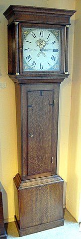 Click here to see more detail of an oak longcase by William Pike of Cirencester