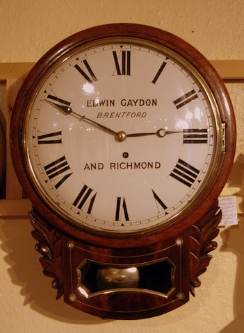 Click here to see more detail of a Regency mahogany inlaid drop dial clock by Edwin Gaydon of Brentford