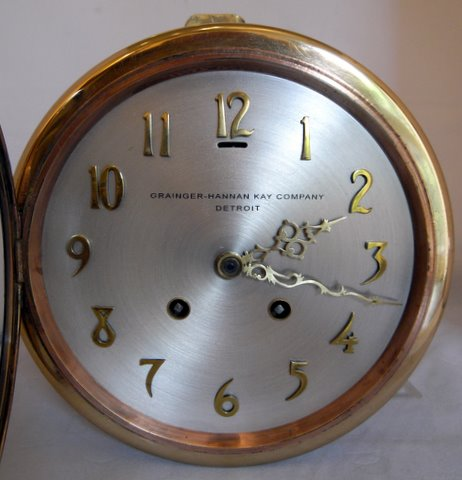 Click here to see more detail of a ship's bulkhead clock by the Chelsea Clock Company
