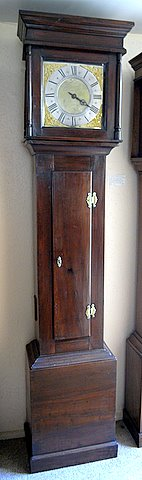 Click here to see more detail of a small 18th century oak longcase by Thomas Shinn of Mathan