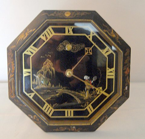 Click here to see more detail of a strut clock in chinoiserie decorated case